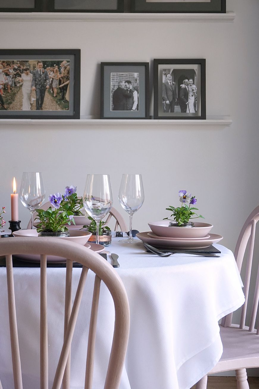 Dining table pink chairs flowers