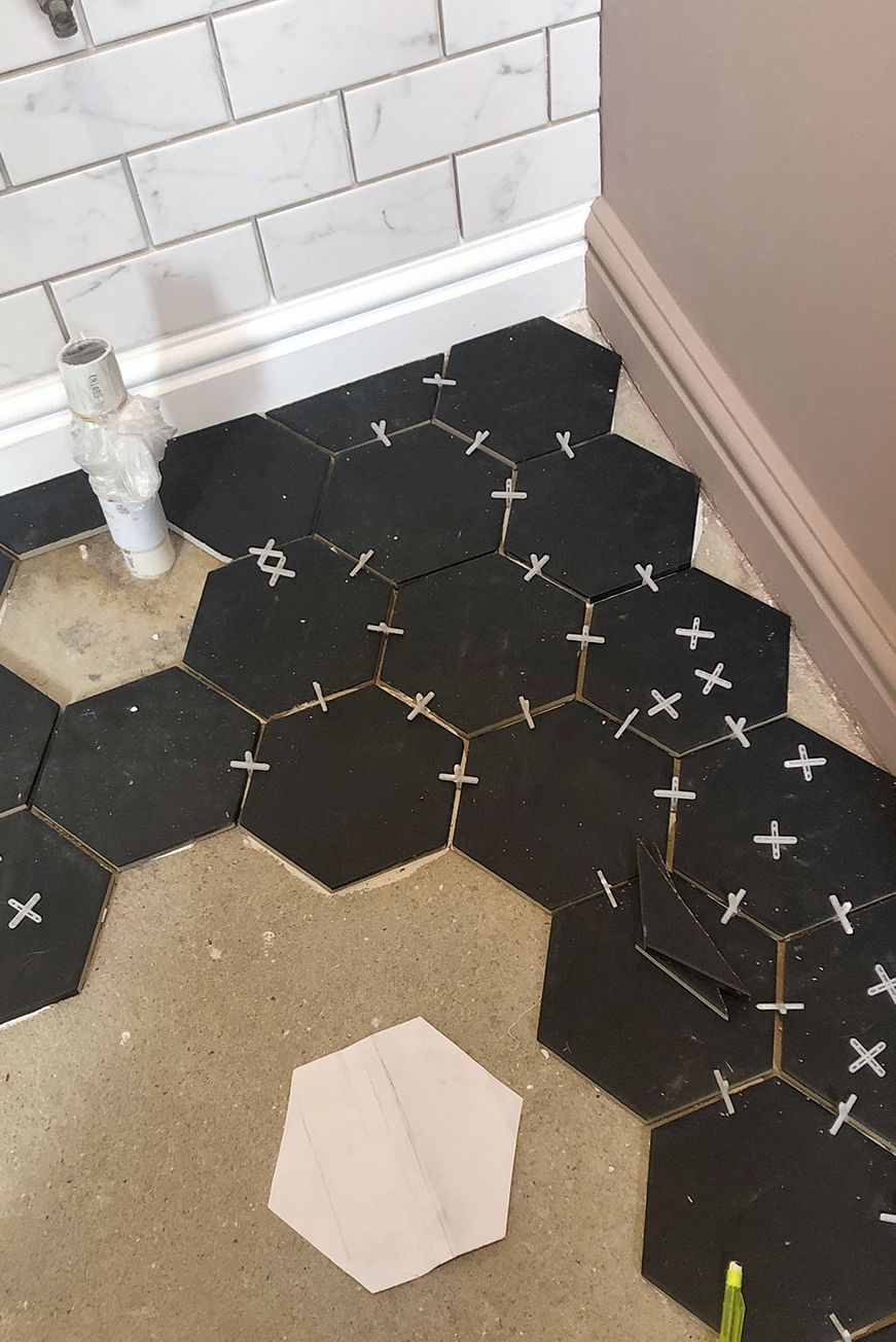 Cloakroom navy hexagon tiles